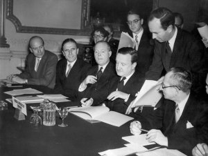 Herman Josef Abs, center, representing Federal Republic of Germany, signs a 1953 agreement cutting Germany's debts to foreign creditors in half.