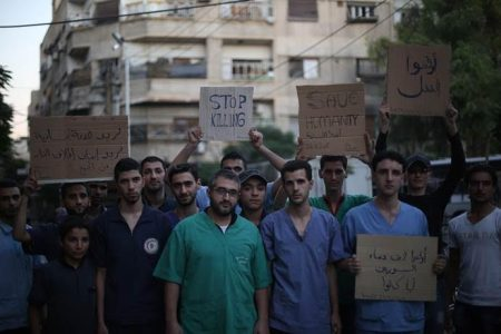 Hospital emergency room staff in Douma, Syria, in August