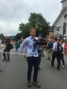 Reporters covering Hillary Clinton's participation in a Fourth of July parade in Gotham, New Hampshire