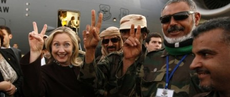 Hillary Clinton with Libyan soldiers in October 2011 (Reuters)